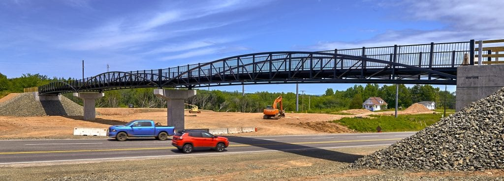 Wide view of triple-span Bowstring Truss Trail Bridge